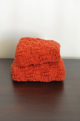 Pile of orange knitting.jpg